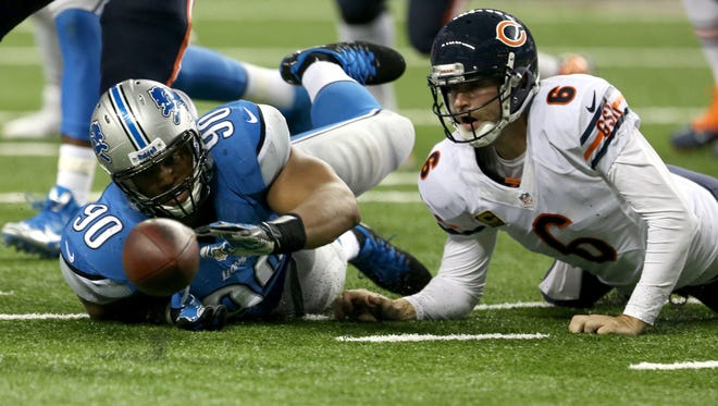 Detroit Lions defensive tackle Ndamukong Suh, left, forces a fumble by the Chicago Bears' Jay Cutler on Sept. 29, 2013, at Ford Field.