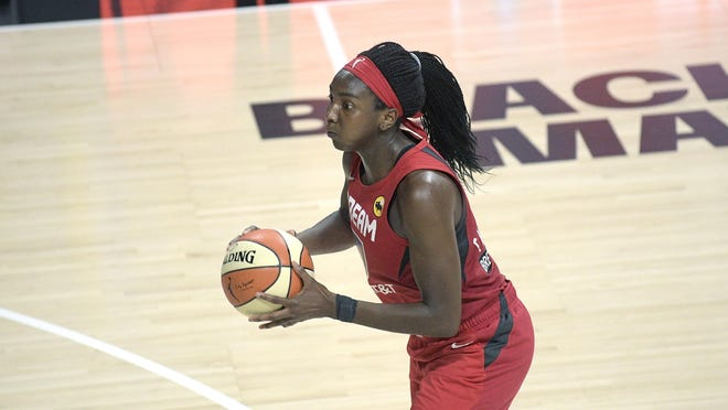 Atlanta Dream center Elizabeth Williams sets up for a shot during the second half of a WNBA basketball game against the Dallas Wings July 26, 2020.