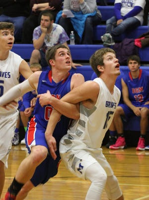 Montezuma's Logan Price, 15, and BGM's Tanner Jansen, 00, eye a potential rebound during the Braves' 71-54 win over the Bears on Thursday, Dec. 4.