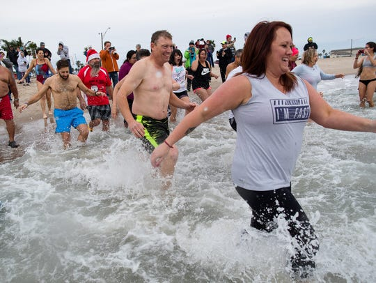 Participants in the annual Polar Bear Plunge at Fajitaville