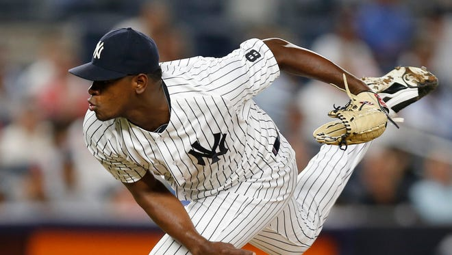 New York Yankees relief pitcher Luis Severino follows through in the fifth inning of the team's baseball game against the New York Mets, Wednesday, Aug. 3, 2016, in New York.