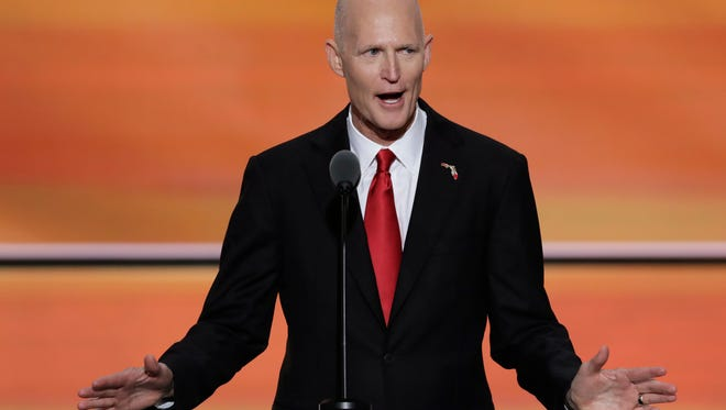 FILE - In this Wednesday, July 20, 2016, file photo, Florida Gov. Rick Scott speaks during the third day of the Republican National Convention in Cleveland. (AP Photo/J. Scott Applewhite, File)