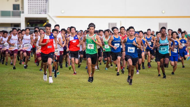 Boys keep pace as they compete during the Independent Interscholastic Athletic Association Cross Country League All-Island cross country meet at John. F. Kennedy High School on Thursday, Oct. 5, 2017