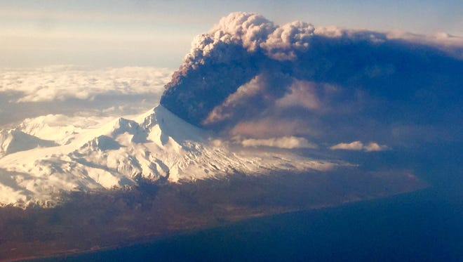 In this Sunday, March 27, 2016, photo, Pavlof Volcano, one of Alaska's most active volcanoes, erupts, sending a plume of volcanic ash into the air. The Alaska Volcano Observatory says activity continued Monday.