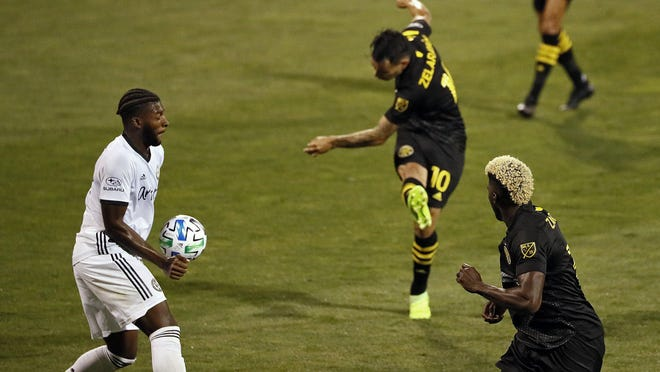 Columbus Crew SC midfielder Lucas Zelarayan (10) scores as the ball hits the hand of Philadelphia Union defender Mark McKenzie (4) during the second half of the MLS game at MAPFRE Stadium in Columbus, Ohio on September 2, 2020.
