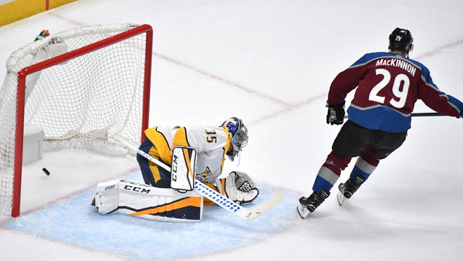 The goal by Colorado Avalanche center Nathan MacKinnon (29) gets by Nashville Predators goaltender Pekka Rinne (35) during the first period of game 3 of the first round NHL Stanley Cup Playoffs at the Pepsi Center, Monday, April 16, 2018, in Denver, Colo.