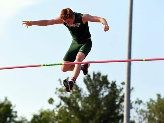 Lawrence North's Nathan Stone completes a vault during the boys IHSAA track and field state finals at Robert C. Haugh Track and Field complex in Bloomington, Ind. on Saturday, May, 2, 2018.