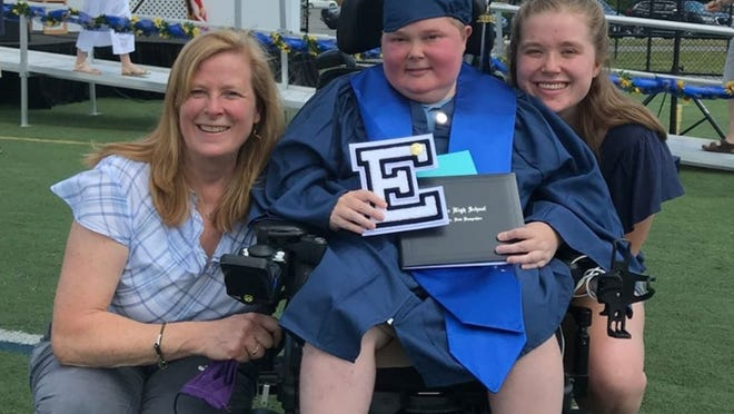 Lucas Currier is pictured with his mother Linda and sister, Alyssa, as he graduated from Exeter High School.