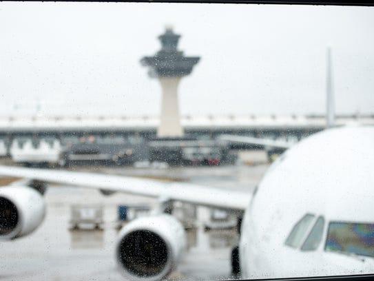 A plane sits at the gate at Washington Dulles International