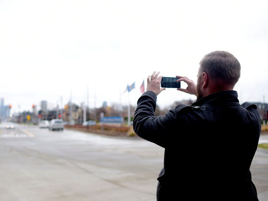 Jon Chezick snaps a photos of the Detroit skyline from