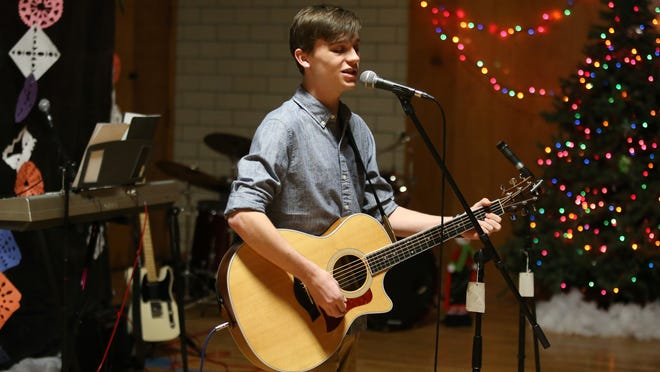 "Grant Ganzer, 16, of Johnston performs during a talent show Dec. 3, 2014, at Youth Emergency Services & Shelter in Des Moines. Ganzer was a contestant on the television program ""The Voice."""