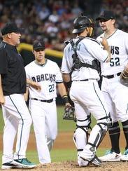 Diamondbacks pitching coach Mike Butcher comes to the