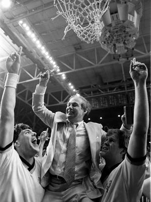 Former Villanova coach Rollie Massimino is boosted aloft to cut the net down after they won the NCAA men's basketball championship in this April 1985 photo.