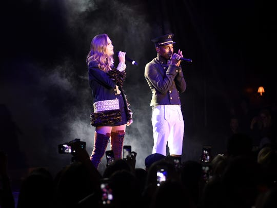 Seen here performing with Pharrell Williams in 2015,