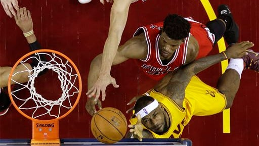 Cleveland Cavaliers forward LeBron James (23) puts up a shot against Chicago Bulls guard Jimmy Butler (21) during the first half of Game 2 in a second-round NBA basketball playoff series Wednesday, May 6, 2015, in Cleveland. James scored 33 points in the Cavaliers' 106-91 win. (AP Photo/Tony Dejak)