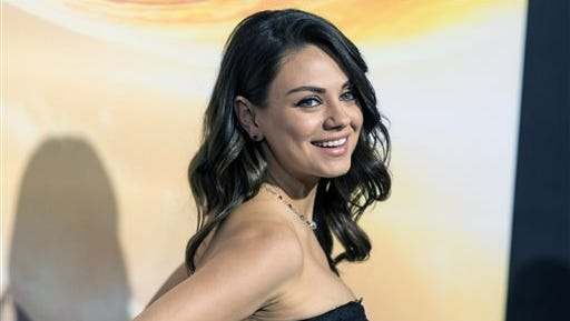 FILE - In this Feb. 2, 2015, file photo, actress Mila Kunis attends a premiere at TCL Chinese Theatre in Hollywood, Calif. Authorities are looking for a man sentenced for stalking Kunis after he escaped from a mental health facility in Southern California, on Saturday, May 30, 2015. (Photo by Paul A. Hebert/Invision/AP, File)