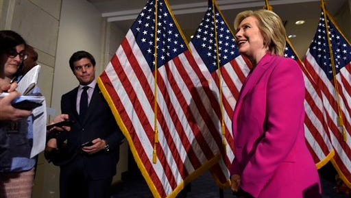 Democratic presidential candidate Hillary Rodham Clinton walks away from the microphones after speaking to reporters on the deal with Iran, Tuesday,  July 14, 2015, on Capitol Hill in Washington, Tuesday, July 14, 2015. Clinton attended meetings on Capitol Hill with House and Senate Democrats. (AP Photo/Susan Walsh)