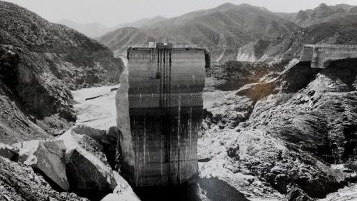 This photo was taken in 1928 days after it collapse in San Fransicisquito Canyon, east of Santa Clarita. The failure of the St. Francis Dam on March 12, 1928, is regarded as the worst American civil engineering failure of the 20th century, affecting Santa Paula and the Santa Clara River Valley profoundly. More than 400 people lost their lives, and the tragedy brought an end to the legendary career of William Mulholland, the self-taught engineer who built the Owens River Aqueduct that made modern Los Angeles possible.