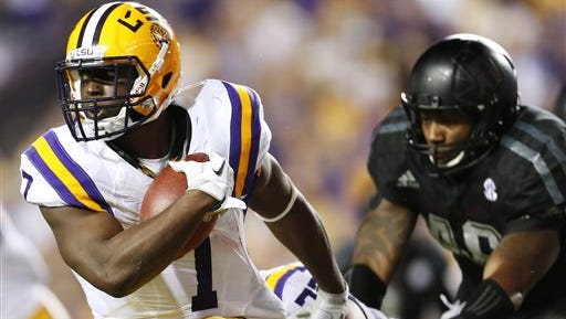 LSU running back Leonard Fournette (7) runs with the ball during the first half  against Texas A&M.