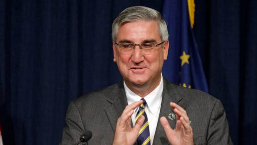 Indiana Lt. Gov. Eric Holcomb discusses the state's fiscal condition following the close of Fiscal Year at the Statehouse in Indianapolis, Monday, July 25, 2016. Holcomb is Gov. Mike Pence's pick to take his place as the Republican candidate for governor following his withdrawal to become Donald Trump's vice presidential running mate. The Republican state committee will meet to pick the replacement Tuesday. (AP Photo/Michael Conroy)