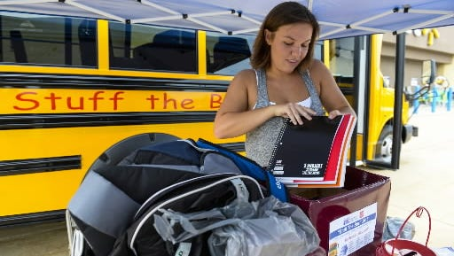 Hannah Reese, a volunteer with the United Way of Lebanon County, organizes school supplies at the Stuff the Bus outside of the Wal-Mart in Lebanon on Monday, July 13, 2015. The United way of Lebanon County and Salvation Army annual event sponsor the event, which benefits school children in Lebanon County.