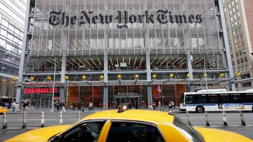FILE - In this Oct. 18, 2011, file photo, traffic passes the New York Times building, in New York. The New York Times pushed back against President-elect Donald Trump, saying Thursday, Nov. 17, 2016, that its paid subscriptions have jumped since the election, despite what Trump has said on Twitter.