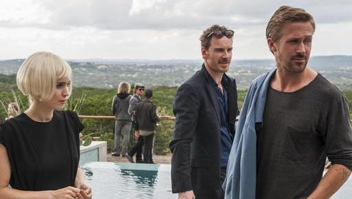 """This image released by Broad Green Pictures shows Rooney Mara, from left, Michael Fassbender, and Ryan Gosling in Terrence Malick's film, """"Song to Song.""""  Malick's long-awaited """"Song to Song,"""" which was recently retitled from """"Weigthless,"""" will open the 24th South by Southwest Film Festival on March 10, the festival announced Thursday, Jan. 5, 2017."""