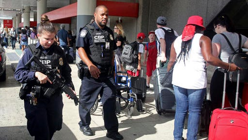 A heavy police presence was at the Ft. Lauderdale-Hollywood International Airport after it re-opened Saturday, Jan. 7, 2017. Investigators continued their work downstairs in the baggage area of terminal 2 the day after a shooting.