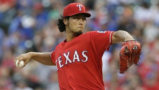 In this July 27, 2016, file photo, Texas Rangers starting pitcher Yu Darvish throws during the third inning of a baseball game against the Oakland Athletics in Arlington, Texas. Darvish and Cole Hamels, the Rangers two aces, are set to start a season in the rotation together for the first time.