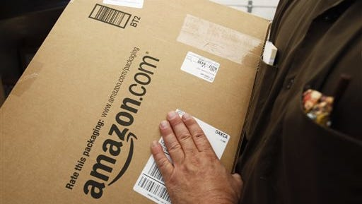File photo of an Amazon.com package being prepared for shipment by a United Parcel Service (UPS).