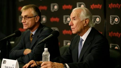 Paul Holmgren, left, will remain general manager despite Ron Hextall waiting in the wings.