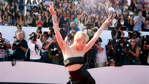 Miley Cyrus arrives at the MTV Video Music Awards at The Forum on Sunday in Inglewood, Calif.