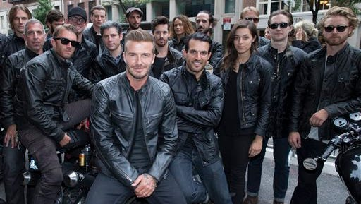 David Beckham poses for a photograph with motorcyclists as he promotes the Beckham for Belstaff collection during Fashion Week, Tuesday in New York.