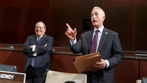 Rep. Trey Gowdy, R-S.C., chairman of the House Select Committee on Benghazi, arrives as his panel holds its first public hearing to investigate the 2012 attacks on the U.S. consulate in Benghazi, Libya, where a violent mob killed four Americans, including Ambassador Christopher Stevens, on Capitol Hill in Washington, Wednesday, Sept. 17, 2014. At left is Chris Donesa, chief counsel. The special probe was called for by leaders in the Republican-controlled House who alleged that U.S. forces were directed not to respond to the attacks and that administration officials lied about the nature of the attack. (AP Photo/J. Scott Applewhite)