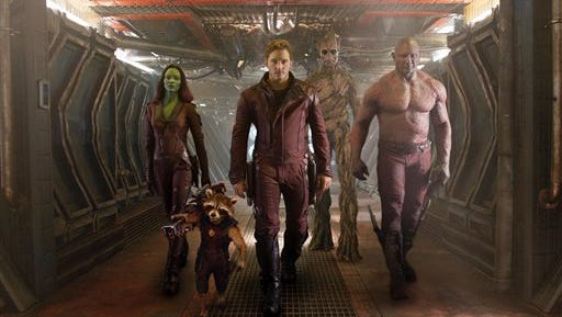 "From left, Zoe Saldana, the character Rocket Racoon, voiced by Bradley Cooper, Chris Pratt, the character Groot, voiced by Vin Diesel and Dave Bautista in a scene from ""Guardians Of The Galaxy."""
