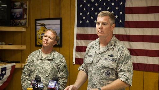Brigadier General Timothy P. Williams, adjutant General of the Virginia National Guard, left, and Brigadier General Robert Brooks, component commander of the Massachusetts Air National Guard, answer questions from members of the media after announcing that the pilot who had been missing from an F-15 jet that crashed near Deerfield, Va. was found dead on Thursday, Aug. 28, 2014. (AP Photo/The Staunton News Leader, Griffin Moores)