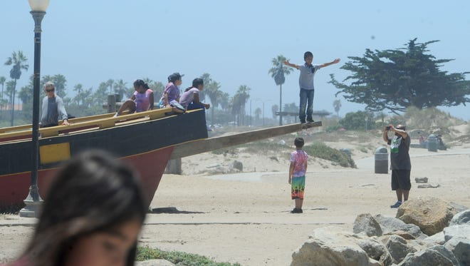 Children play at Marina Park next to the ocean in Ventura.
