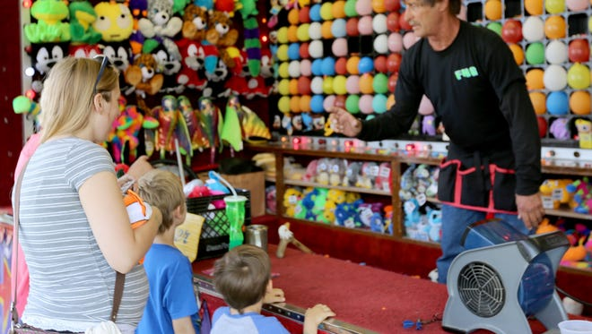 Kids prepare to take their shot at winning prizes at the Manitowoc County Fair Thursday, Aug. 25.