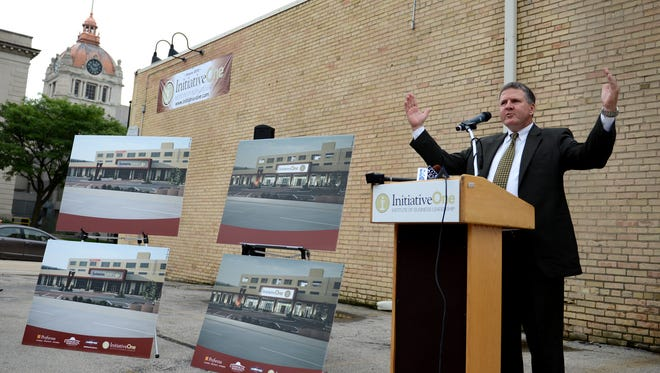 Initiative One founder and CEO Fred Johnson unveiled plans last August to renovate and occupy the building at 110 S. Adams Street in downtown Green Bay.