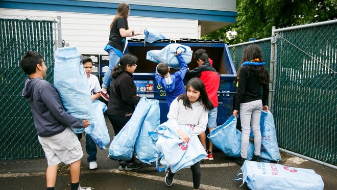 Students in Jeff Lewis' fifth grade class at Four Corners Elementary School take out the recycling as part of end of the year activities on Thursday, June 15, 2017.