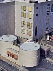 Odors from a pair of sludge blending tanks is vented