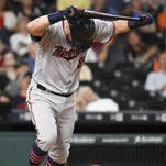 The Minnesota Twins' Trevor Plouffe reacts to flying out in the eighth inning Tuesday against the Houston Astros in Houston.