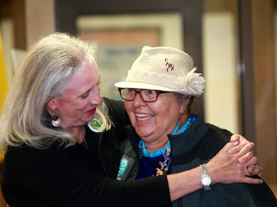 State Senate District 1 candidate Rebecca Morgan, left, greets state House District 4 candidate GloJean Todacheene on Tuesday at the San Juan County Democratic headquarters in Farmington.