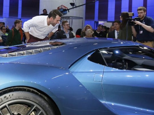 Detroit Tigers pitcher Justin Verlander looks over the interior of the new Ford GT super car that he has talked about owning during a stop on the Tigers Winter Caravan at the North American International Auto Show   on Jan.23, 2015.