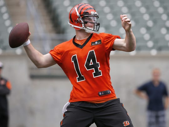 Bengals quarterback Andy Dalton throws a pass during minicamp practice Wednesday.