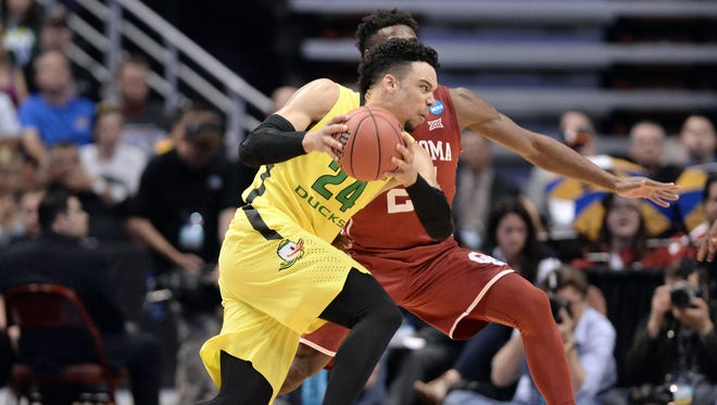 March 26, 2016; Anaheim, CA, USA; Oregon Ducks forward Dillon Brooks (24) moves the ball against Oklahoma Sooners guard Buddy Hield (24) during the first half of the West regional final of the NCAA Tournament at Honda Center. Mandatory Credit: Robert Hanashiro-USA TODAY Sports