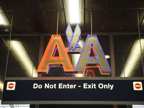 An American Airlines sign is seen over a terminal exit at Chicago's O'Hare airport on Aug. 13, 2013.