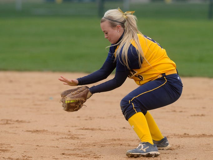 Augie's Maddie Merriam scoops up a ground ball as they face Minnesota Duluth Thursday at the NSIC softball tournament at Sherman Park, May 1, 2014.