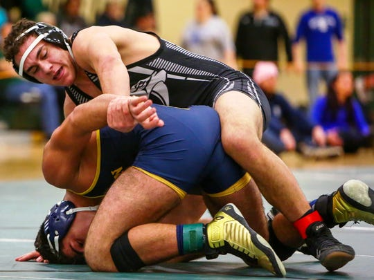 Plymouth's Andrew Attalah (top) won his third place match at 189 pounds against Fordson's Mohamad Zahwi.
