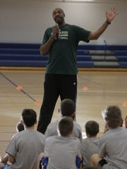 Former Milwaukee Bucks player Vin Baker talks to basketball camp participants Wednesday, Feb. 8, 2017, at the 20th Avenue YMCA in Oshkosh after the franchise announced it will bring a D-League team to the city.